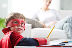 Creative superhero boy Stock Images