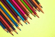Creative task, work. Sharpened pencils are ready for work. Bright, cheerful, positive colors. Brainstorm, joint creativity. View from above Stock Image