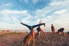 Creative Team of Attractive Teen Girls. ST PETERSBURG, RUSSIA - AUGUST 21, 2016: Creative Team of Attractive Teen Girls is Dancing Outdoors on a Sandy Beach on a Royalty Free Stock Images