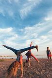 Creative Team of Attractive Teen Girls. ST PETERSBURG, RUSSIA - AUGUST 21, 2016: Creative Team of Attractive Teen Girls is Dancing Outdoors on a Sandy Beach on a Royalty Free Stock Photography