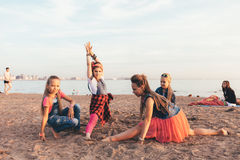 Creative Team of Attractive Teen Girls. ST PETERSBURG, RUSSIA - AUGUST 21, 2016: Creative Team of Attractive Teen Girls is Dancing Outdoors on a Sandy Beach on a Stock Image