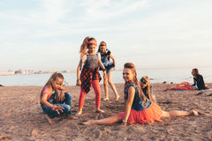 Creative Team of Attractive Teen Girls. ST PETERSBURG, RUSSIA - AUGUST 21, 2016: Creative Team of Attractive Teen Girls is Dancing Outdoors on a Sandy Beach on a Royalty Free Stock Image