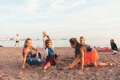 Creative Team of Attractive Teen Girls. ST PETERSBURG, RUSSIA - AUGUST 21, 2016: Creative Team of Attractive Teen Girls is Dancing Outdoors on a Sandy Beach on a Stock Photos