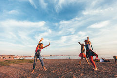 Creative Team of Attractive Teen Girls. ST PETERSBURG, RUSSIA - AUGUST 21, 2016: Creative Team of Attractive Teen Girls is Dancing Outdoors on a Sandy Beach on a Stock Photo