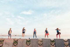 Creative Team of Attractive Teen Girls. ST PETERSBURG, RUSSIA - AUGUST 21, 2016: Creative Team of Attractive Teen Girls is Posing Outdoors on a Sandy Beach on a Stock Photos