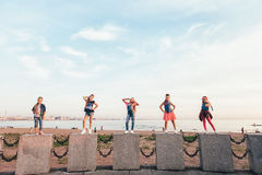 Creative Team of Attractive Teen Girls. ST PETERSBURG, RUSSIA - AUGUST 21, 2016: Creative Team of Attractive Teen Girls is Posing Outdoors on a Sandy Beach on a Royalty Free Stock Photos