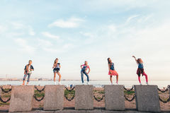 Creative Team of Attractive Teen Girls. ST PETERSBURG, RUSSIA - AUGUST 21, 2016: Creative Team of Attractive Teen Girls is Posing Outdoors on a Sandy Beach on a Stock Photography