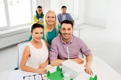 Creative team with blueprint working at office. Architecture , construction and people concept - creative team of architects or designers with project blueprint stock photos