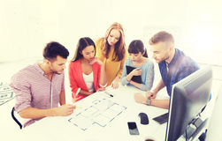 Creative team with blueprint working at office Stock Photo