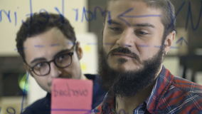 Creative team brainstorming and sharing ideas stock video footage