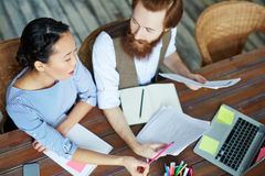 Creative Team Discussing Project Plan in Office Royalty Free Stock Photo