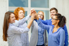 Creative team doing high five gesture in office Royalty Free Stock Photo