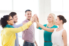 Creative team doing high five gesture in office Stock Photography