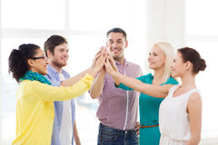 Creative team doing high five gesture in office Royalty Free Stock Photography