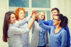 Creative team doing high five gesture in office Stock Photo