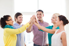 Creative team doing high five gesture in office Stock Image
