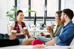 Creative team drinking coffee at office Stock Photos