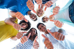 Creative team gesturing thumbs up Stock Images
