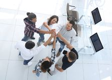 Creative team giving each other a high five. View from the top.creative team giving each other a high five.photo with copy space royalty free stock image