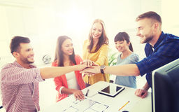 Creative team holding hands together  at office Stock Photos