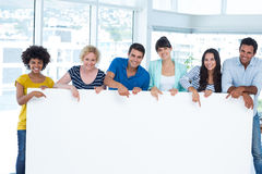 Creative team holding a panel Royalty Free Stock Photo