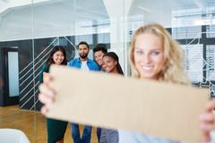 Creative team holds blank sign Stock Image