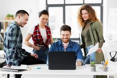 Creative team with laptop working at office Royalty Free Stock Image