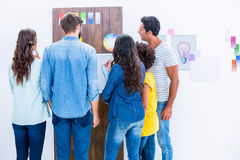Creative team looking at color sample Royalty Free Stock Images