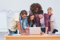 Creative team looking at laptop Stock Photography