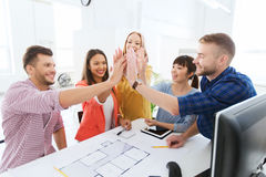 Creative team making high five at office Stock Photo