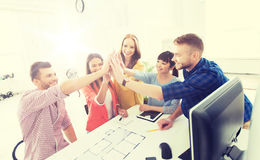 Creative team making high five at office Stock Photos