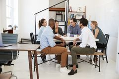 Creative team meeting around a table in an office Royalty Free Stock Photography