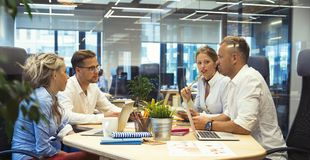 People in meeting room talking about finances stock image
