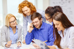 Creative team with papers and clipboard at office Royalty Free Stock Image