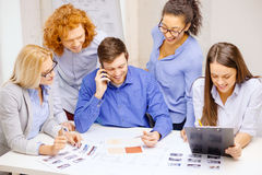 Creative team with papers and clipboard at office Royalty Free Stock Photo