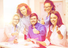 Creative team with papers showing thumbs up Royalty Free Stock Photography