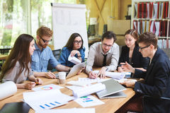 Creative team of professionals at the table. Meeting diverse people participating in creative sustainable ideas in modern startup office. Coworking stock image