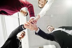 Creative team putting their hands together in circle. Team work. Creative team putting their hands together in circle stock photo