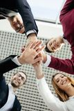 Creative team putting their hands together in circle. Team work. Creative team putting their hands together in circle stock images
