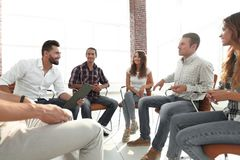 Team sitting in a lesson on team building. Creative team sitting in a lesson on team building Royalty Free Stock Photography