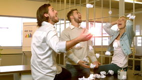 Creative team throwing crumpled balls of paper