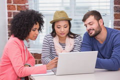 Creative team using laptop in meeting Stock Photos