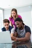 Creative team using laptop Stock Photo