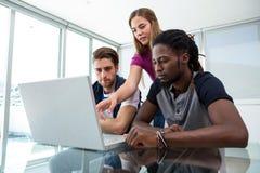 Creative team using laptop Stock Image