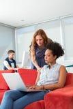 Creative team using laptop on sofa Royalty Free Stock Image