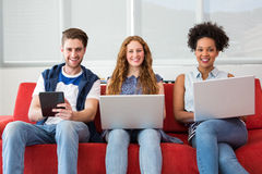 Creative team using laptops and digital tablet Royalty Free Stock Photography