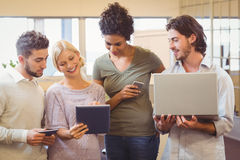 Creative team using tablet pc in office Royalty Free Stock Image