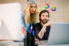 Creative team working at desk Stock Images