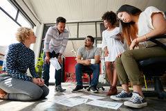 Creative team working on floor at work space Stock Photography