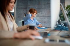 Creative team working at office - women designers working stock images